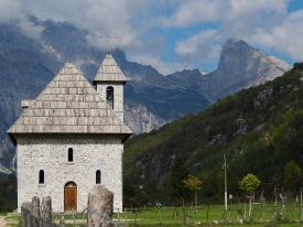 The church in Theth with the Accursed Mountains as a backdrop